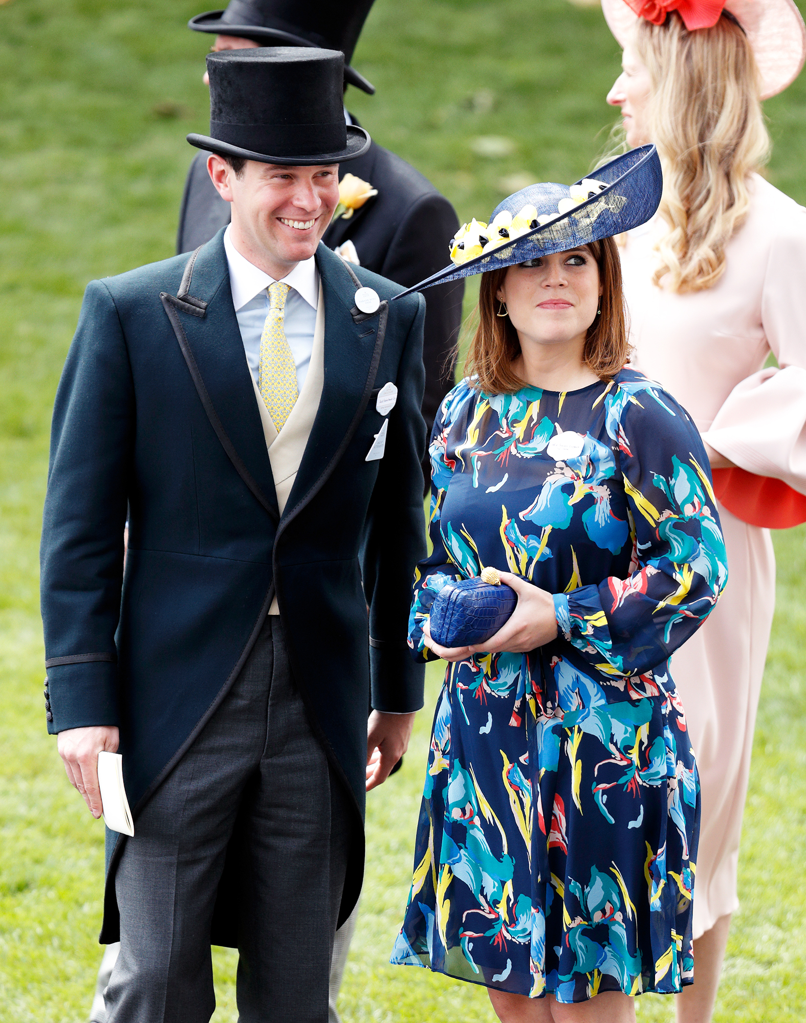 Princess Eugenie and  Jack Brooksbank. Princess is wearing a blue dress and Jack is wearing a suit.