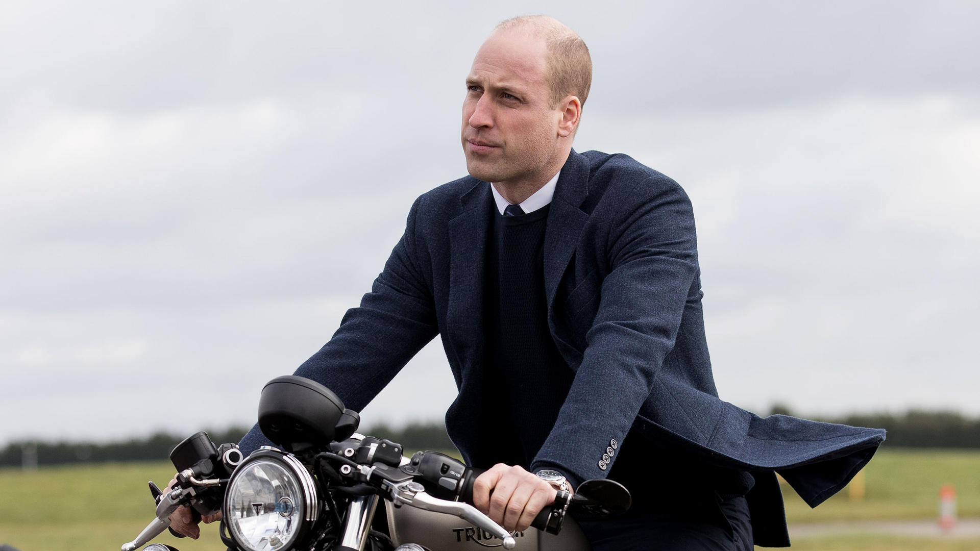 Prince William riding a motorcycle