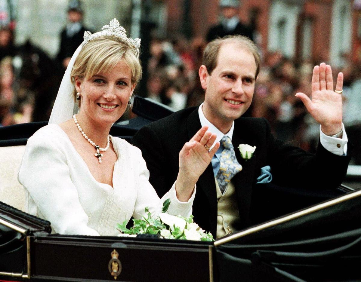 Prince Edward, Earl of Wessex and Countess Sophie waving hands at the crowd.
