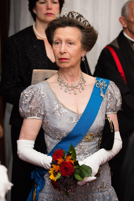 Princess Anne holding a flower bouquet