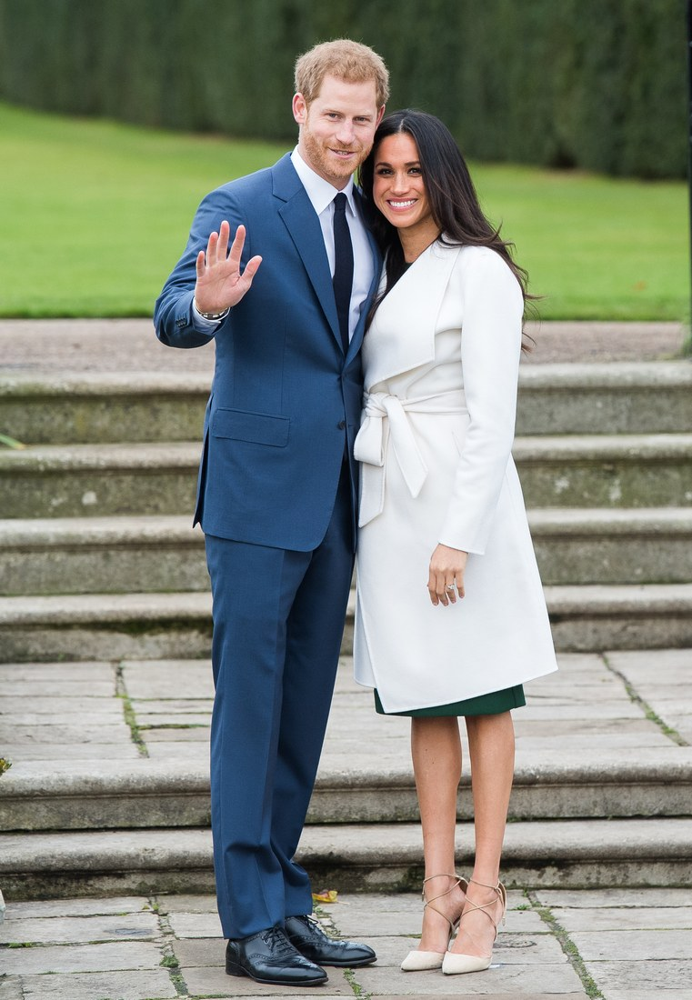 Prince Harry and Meghan Markle posing during the official photo-call to announce their engagement on November 27, 2017 at The Sunken Gardens, Kensington Palace.