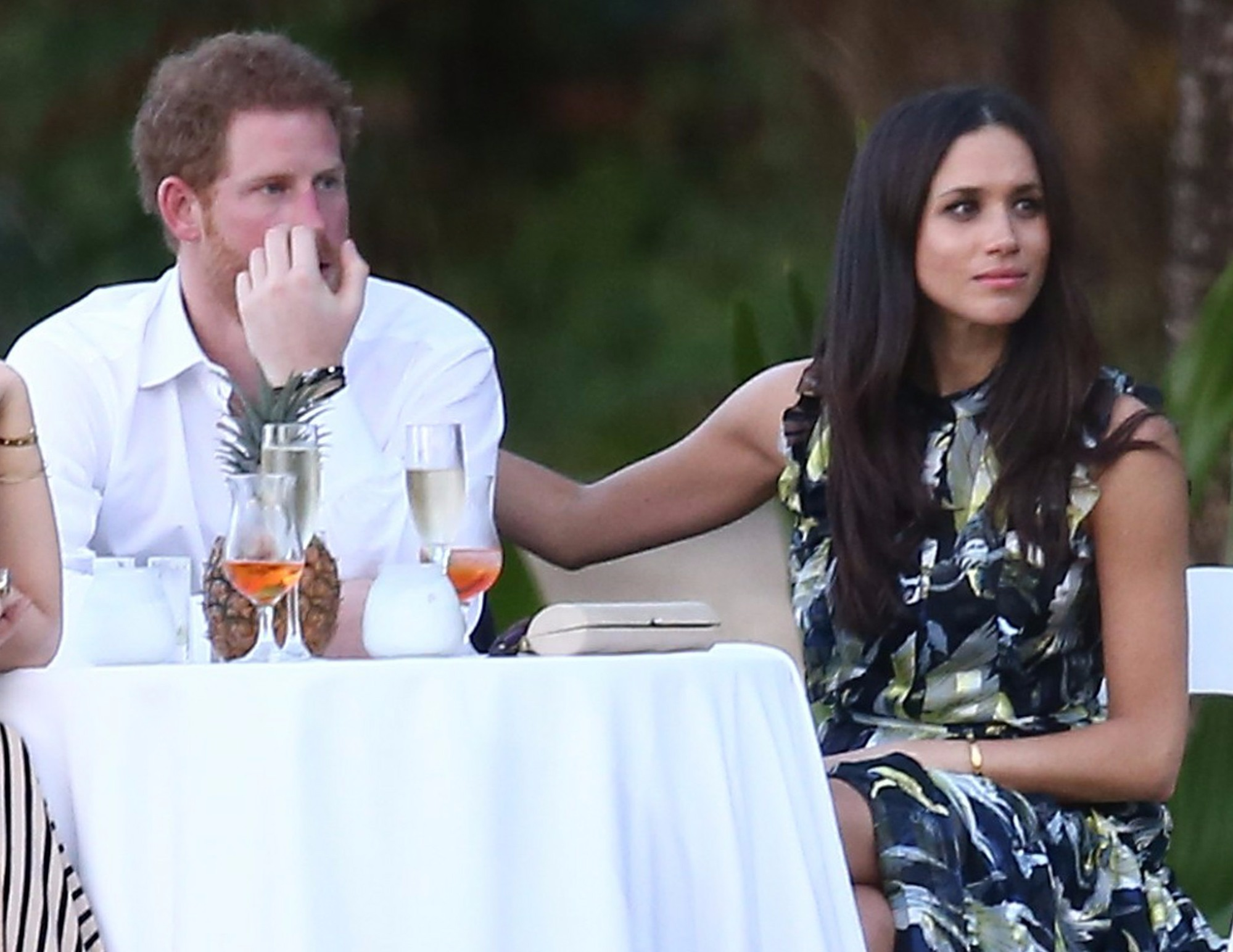 Prince Harry and Meghan at a table in a wedding in Jamaica