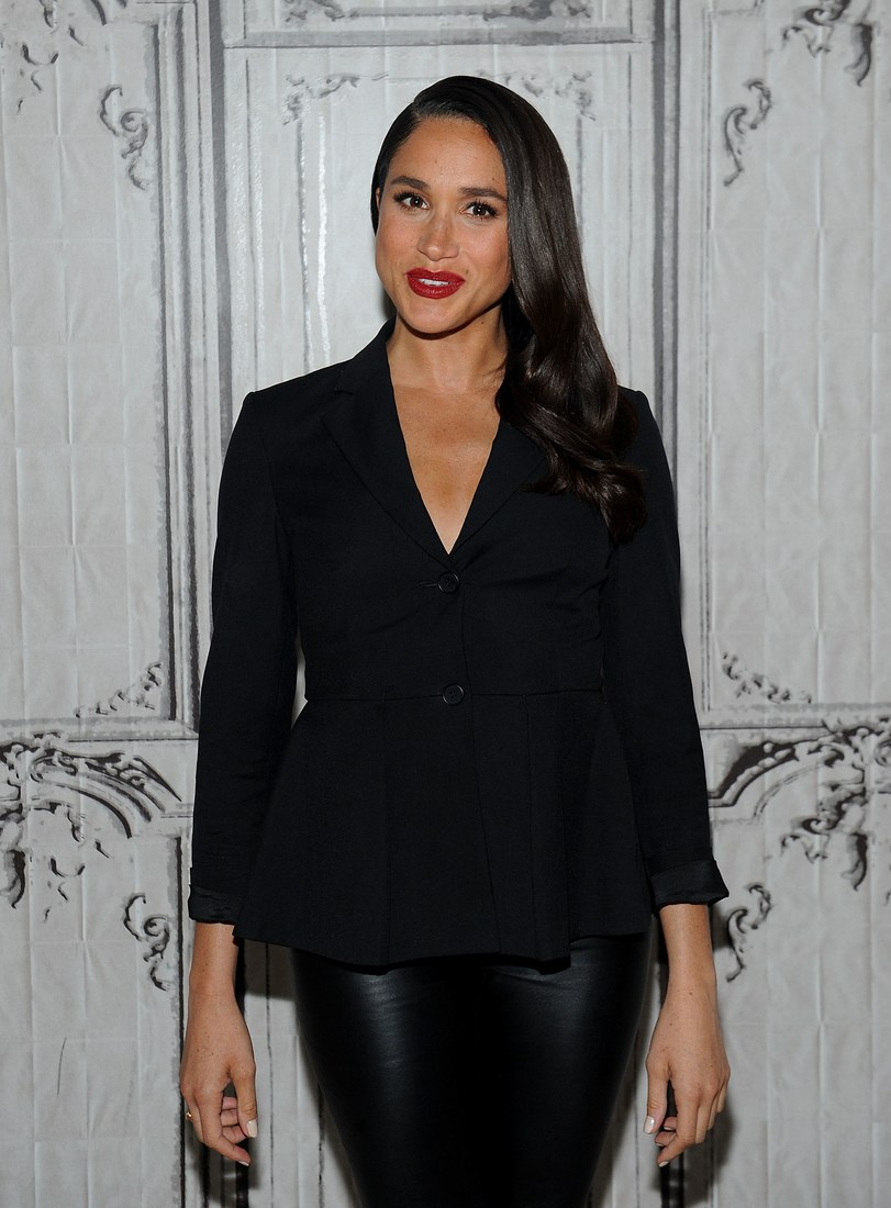 "Actress Meghan Markle poses at AOL Studios, New York white attending AOL Build Presents ""Suits"" on March 17, 2016."