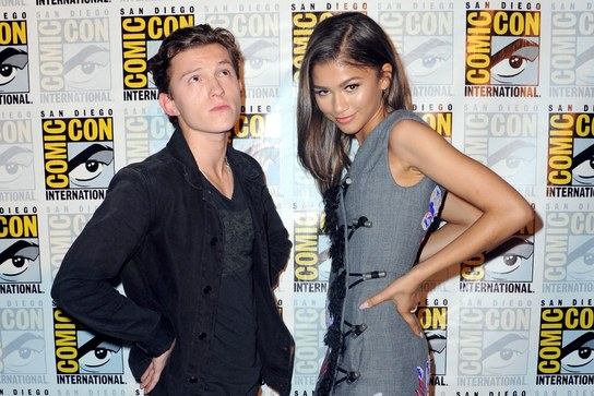 Tom Holland and Zendaya at Comic Con carpet, both of them have hands on their hips