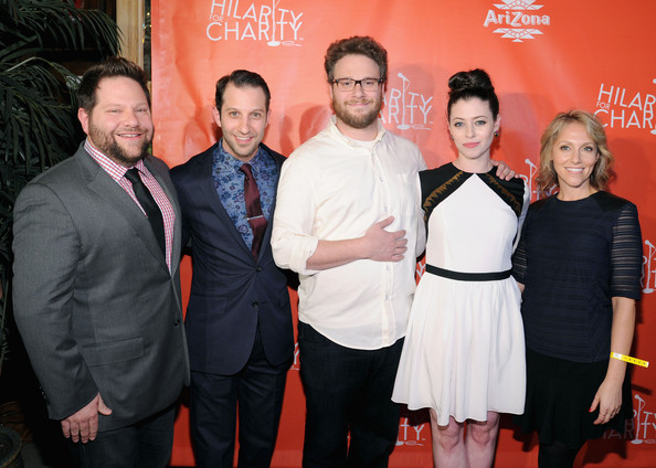 Lauren Miller and seth Rogen are standing together along with the other members of Hilarity for Charity.