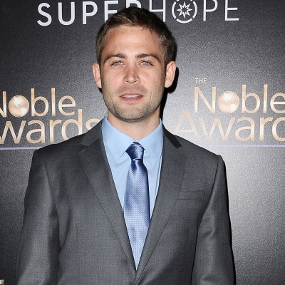 Cody Walker looks total clad in the grey suit and blue tie. He is attending the event Nobel Awards.