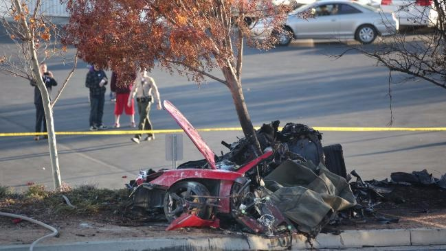 The red car which Paul Walker and his friend Roger Rodas was riding is hitting a tree. The car is badly damaged and burnt.