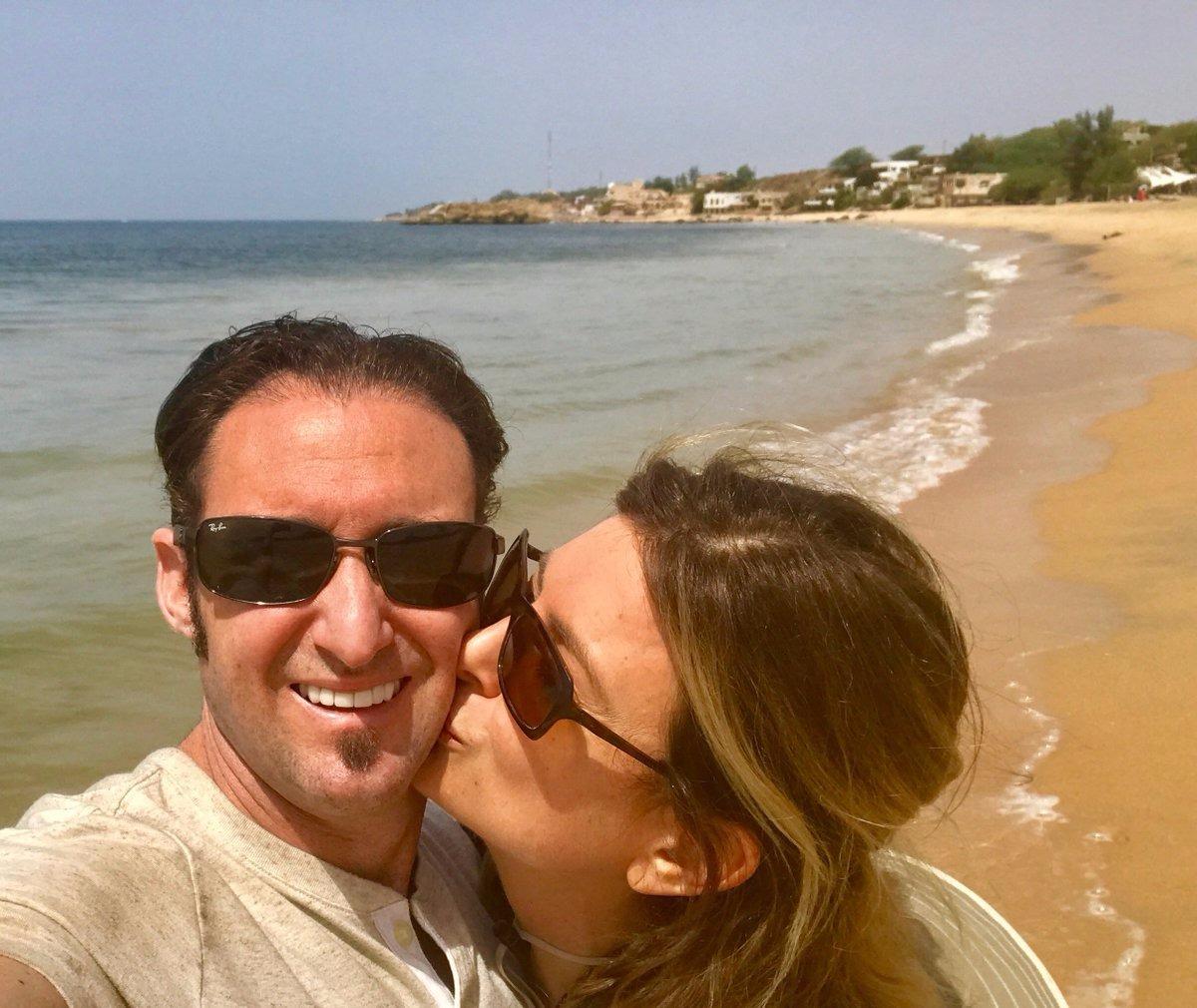 Lisa Bloom planting a kiss on her husband Braden Pollock's cheek