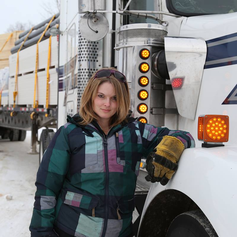 Lisa Kelly is leaning on truck