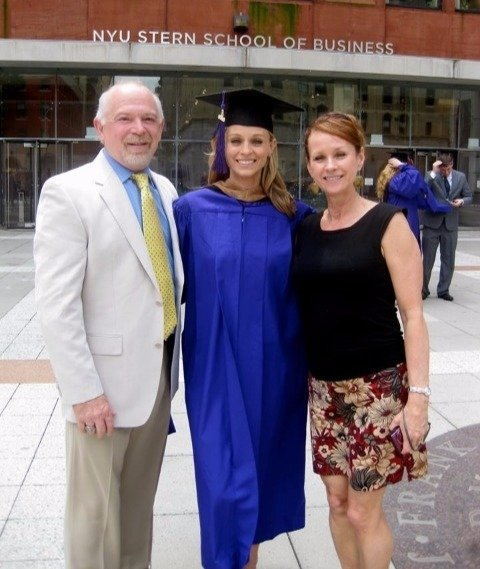 Courtney Reagan photographed with her parents at her graduation day