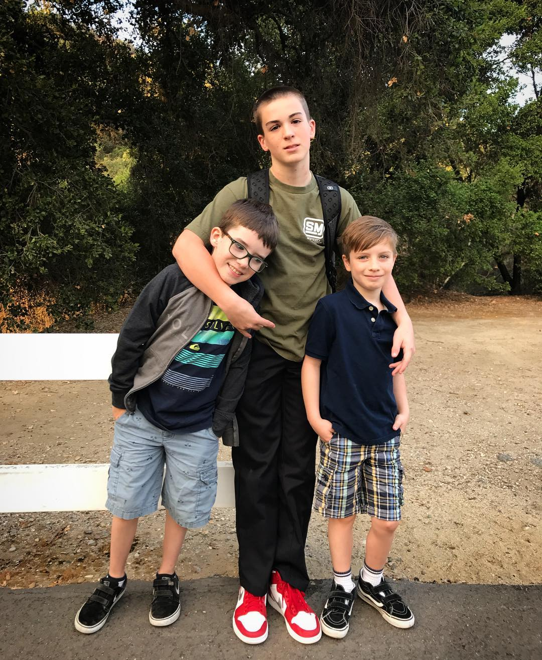 Holly Marie Combs all three sons standing together. Her eldest son Finley Arthur is embracing Riley Edward and Kelly James in either sides.
