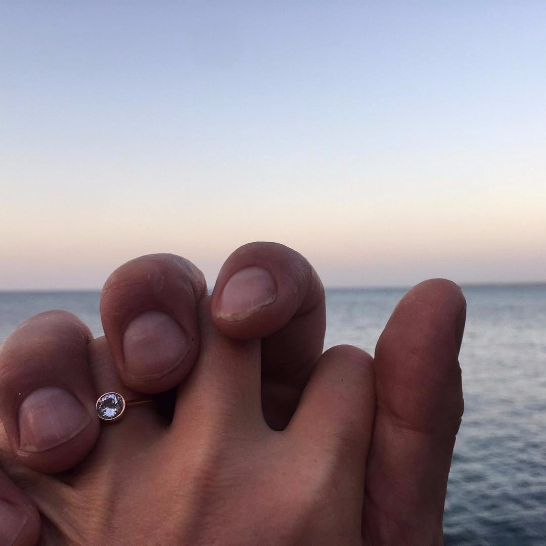 Julia Stiles posted picture of her and fiance Preston's hands, showing her ring