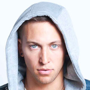 Matt Steffanina is staring at the camera with his incredible blue eyes. He is putting on grey hood and looks breathtaking.