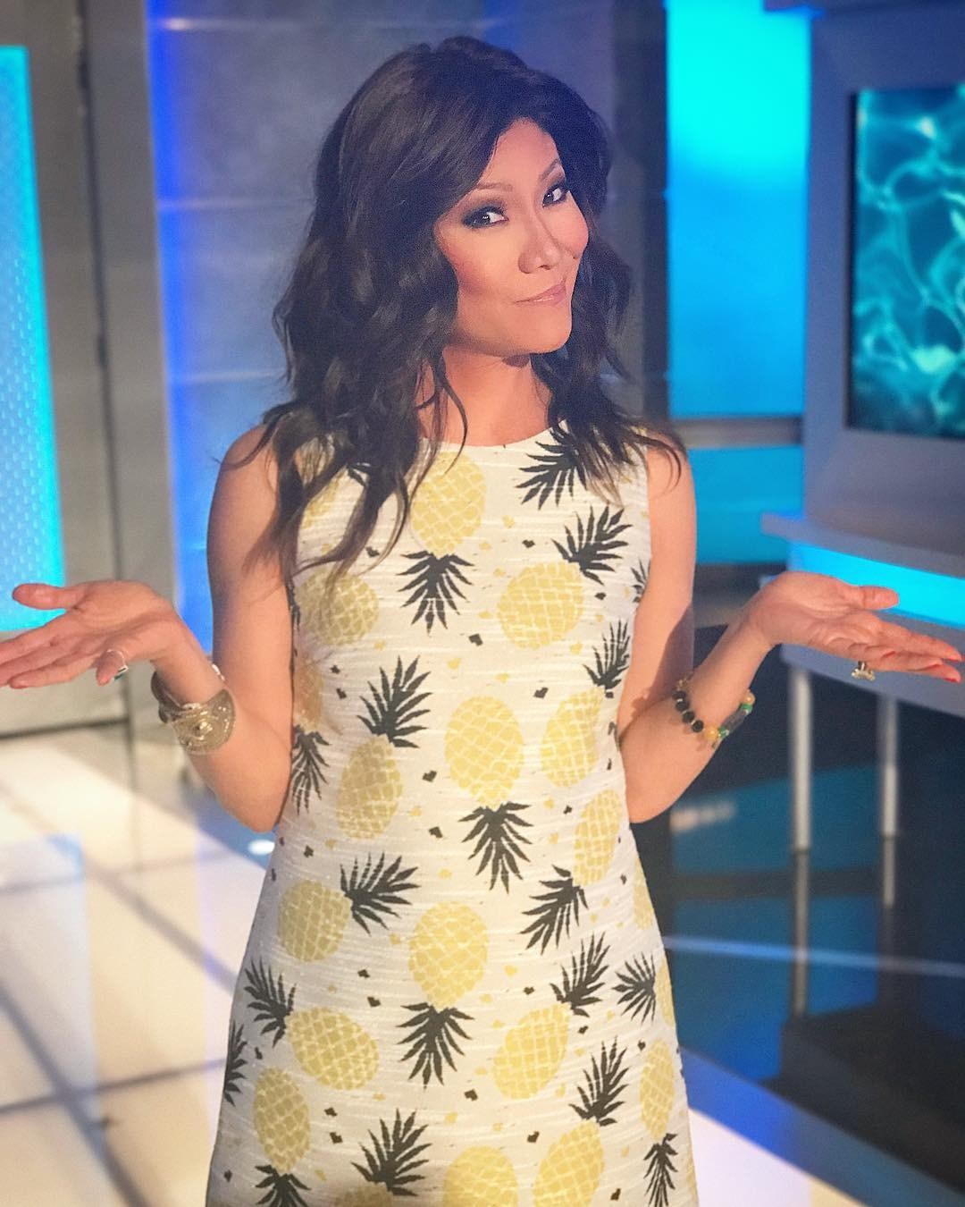 Julie Chen is looking gorgeous in her pineapple printed skirt. She is on the set of Big Brother.