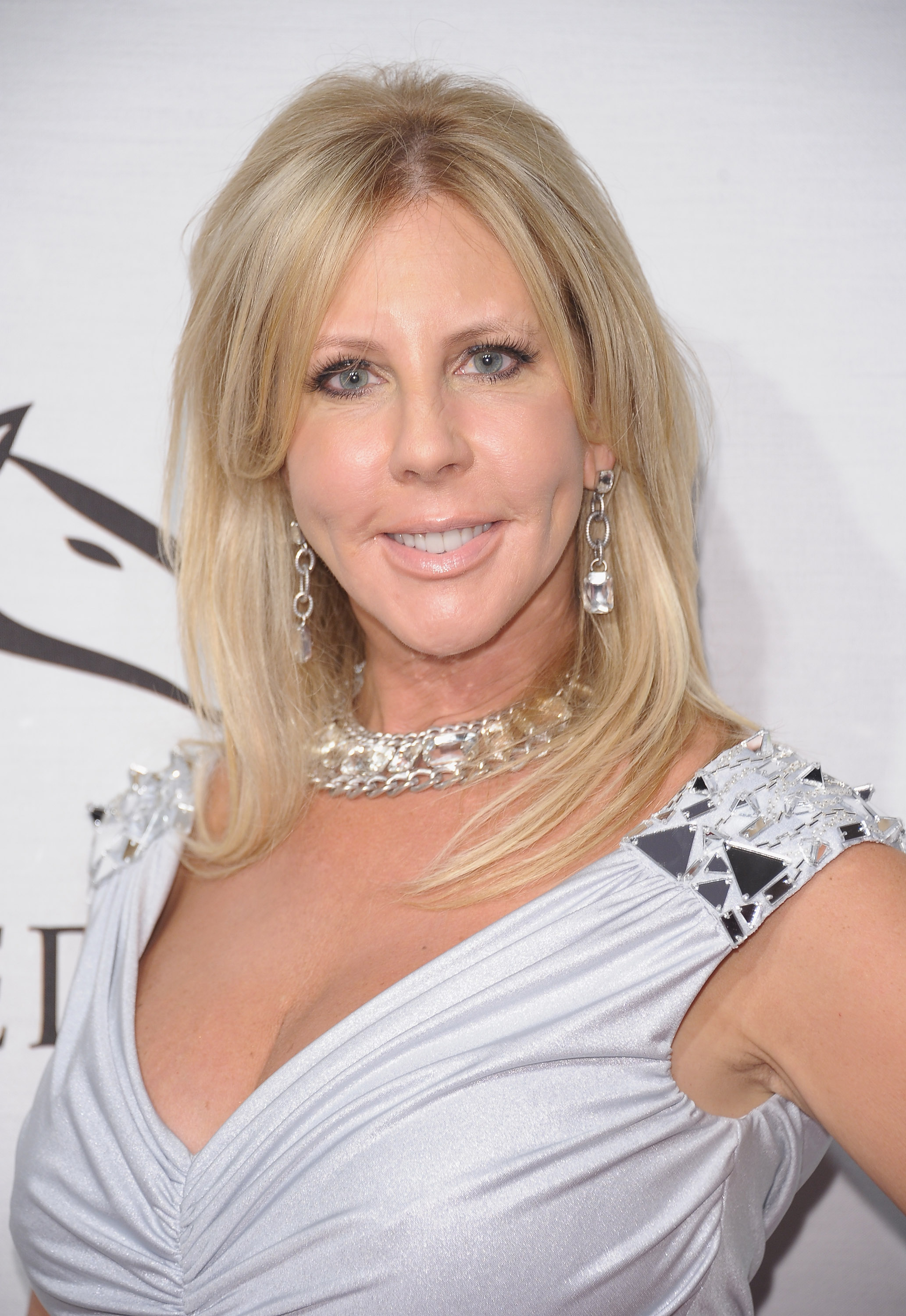 Vicki Gunvalson in a white dress looking at the camera