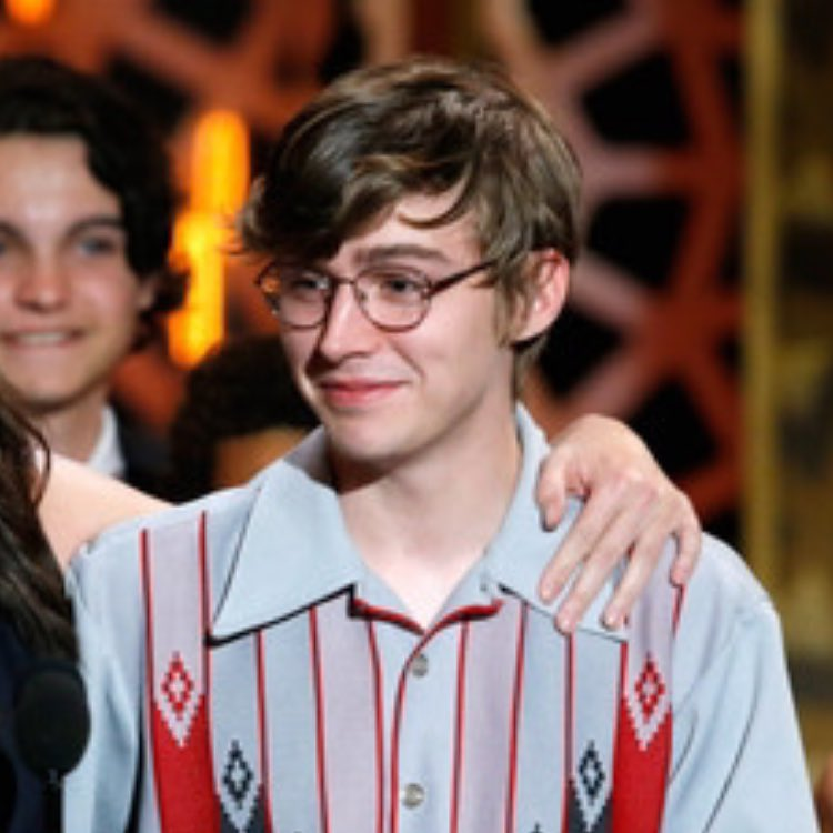 Young Miles Heizer is wearing a nerd glass