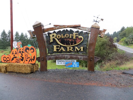 A signboard of Roloff Farm, accompanied by a graphical board of pumpkin patch
