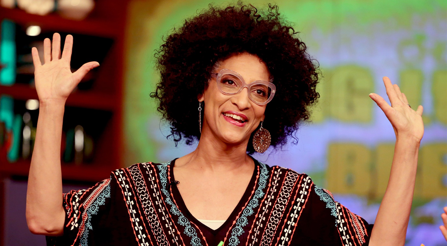 Carla Hall of raising her both hands on the set of 'The Chew'. She is one of the four co-hosts of ABC cooking-related talk show 'The Chew'.