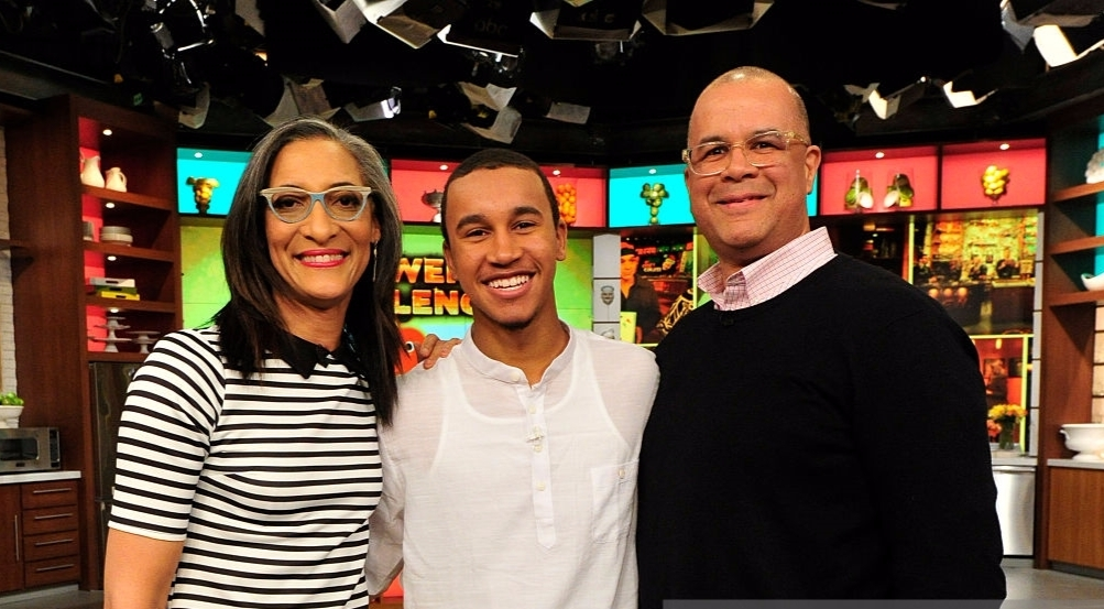 Chef Carla Hall posing with hubby Mathew Lyons and stepson Noah