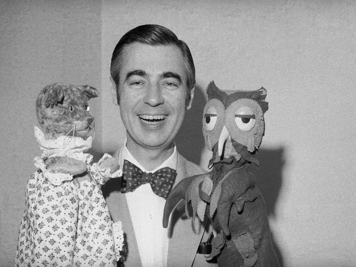 """Roger was shy, overweight, and wore bright sweaters that were knitted by his mother. He was bullied and was called """"Fat Fred"""" due to which he spent most of his days playing with puppets."""