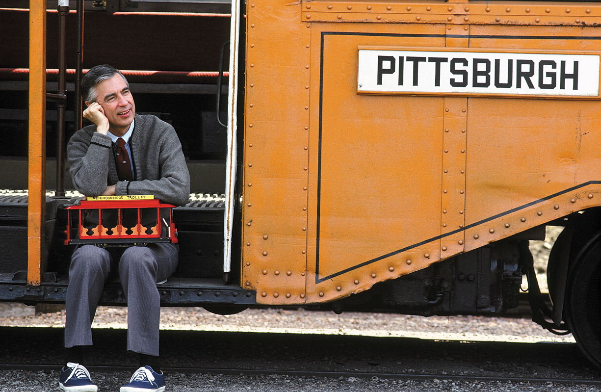 Fred Rogers sitting on a trolley. While the Mister Rogers' Neighborhood was on a break, the actor wrote, produced and hosted an adult interview program, Old Friends…New Friends on PBS. On December 7, 1998, he appeared as the first guest in Soviet children's TV show, Good Night, Little Ones.