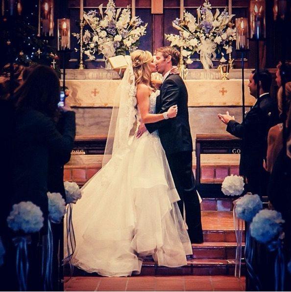 Heidi Watney is kissing her husband Mike Wickham. Watney looks stunning in her wedding dress.