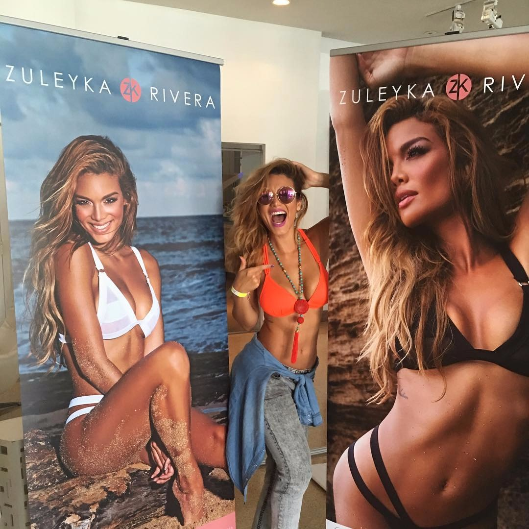 Zuleyka Rivera in between huge sign boards of herself modeling her swimwears