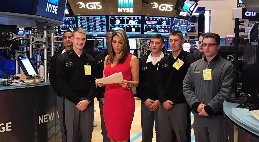 Nicole Petallides with co-workers at New York Stock Exchange office