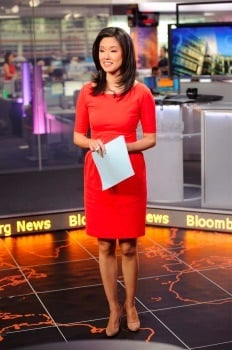 Betty Liu looks smart in her orange one piece and her neatly done hair while delivering news.