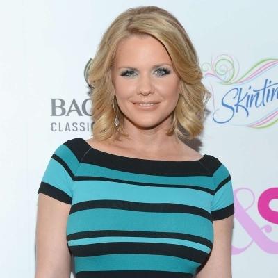 Carrie Keagan dressed in blue and black stripe dress