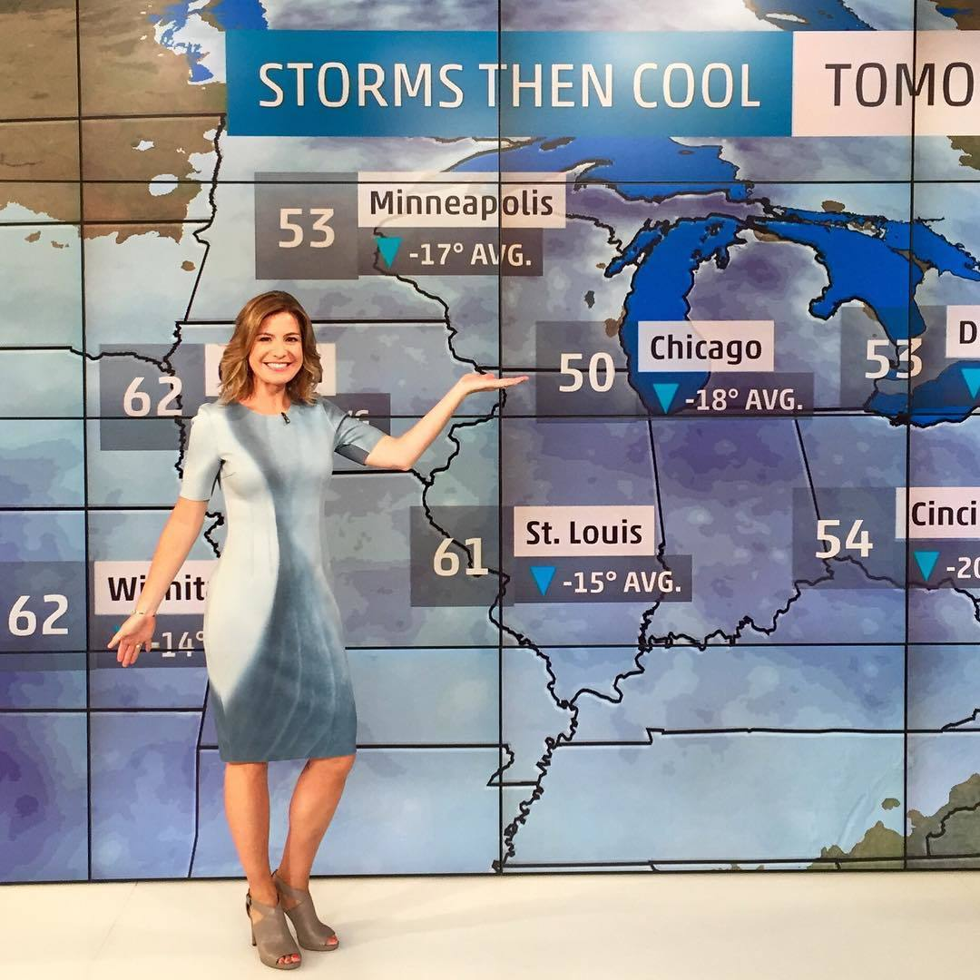 Jen Carfagno presenting weather reports on the Weather Channel. She is flaunting her well-defined body measurements in the fitting dress.
