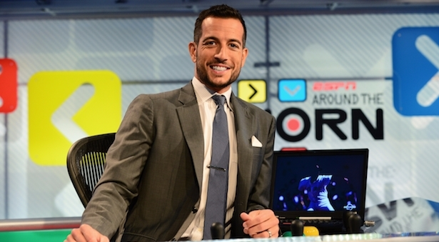 Tony Reali is sitting on a chair