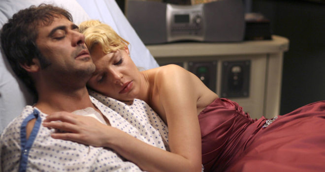 Katherine Heigl as Izzie Steven lying on bed with her patient, Denny Duquette, on the set of Grey's  Anatomy
