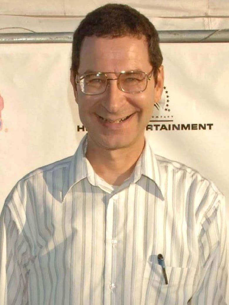 Eddie Deezen smiling. He is wearing white shirt