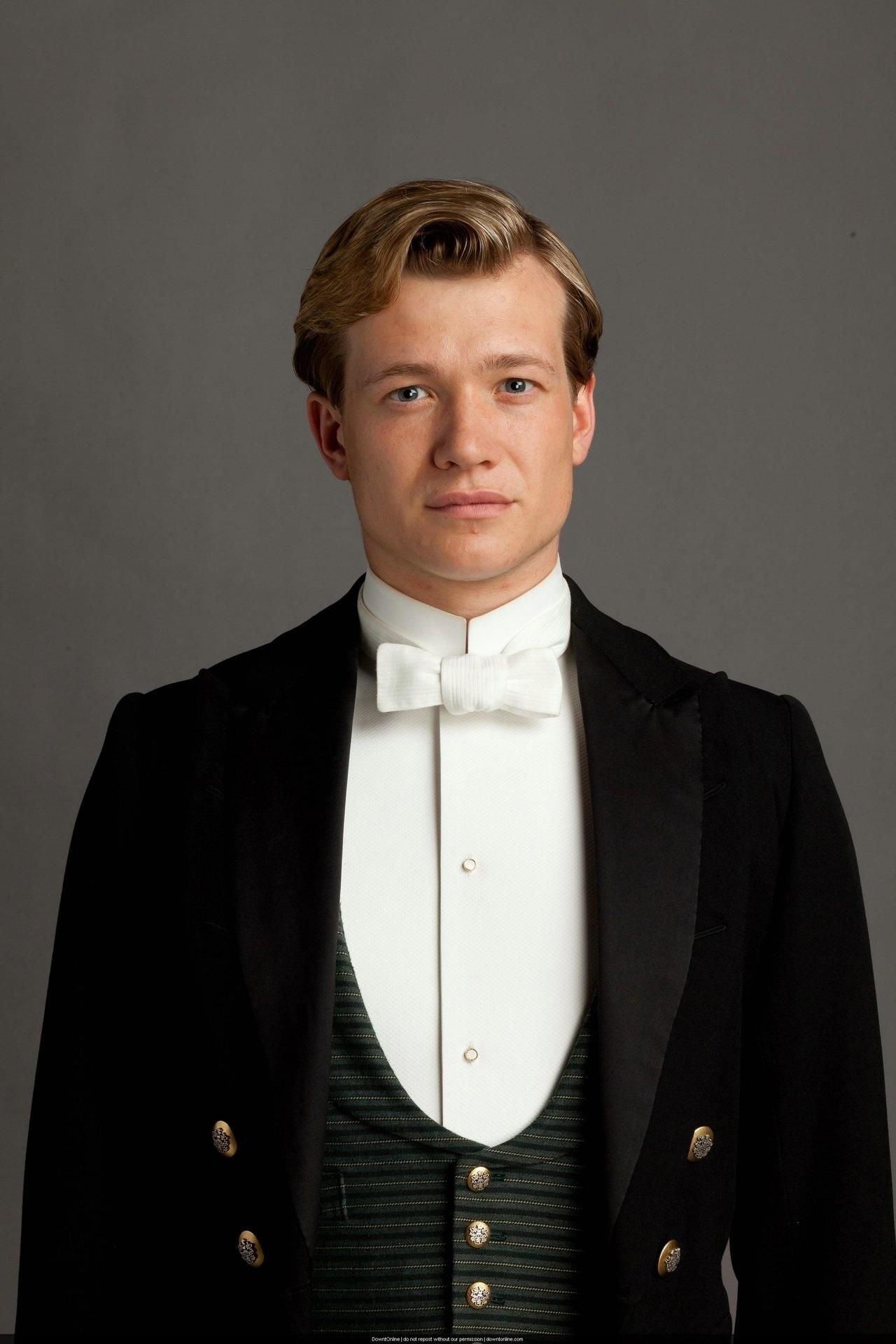 Ed Speleers wearing a suit with a bow tie