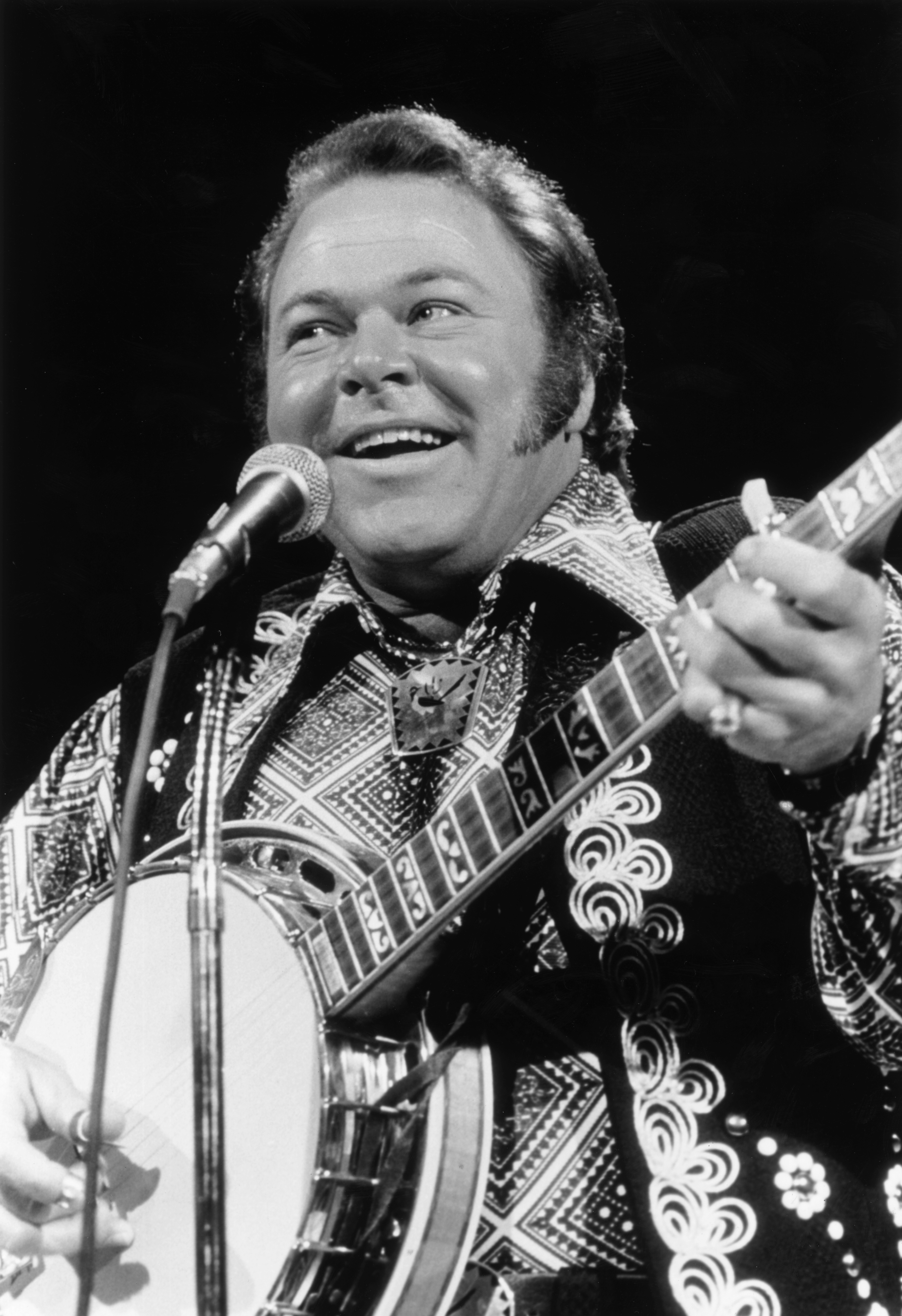Roy Clark performing at a stage