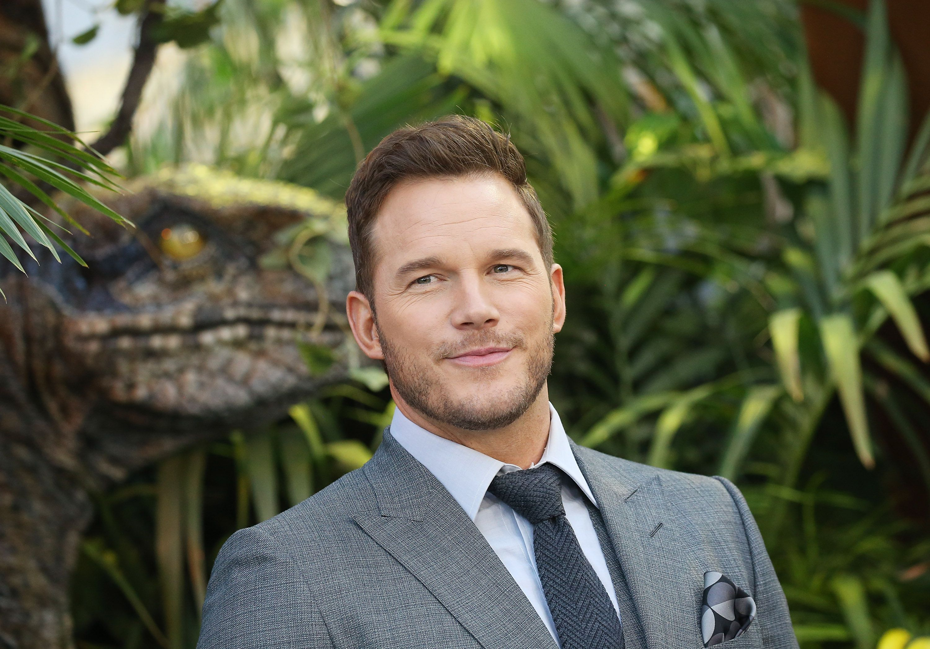 Chris Pratt giving a slight smile for a picture. He is wearing a three piece