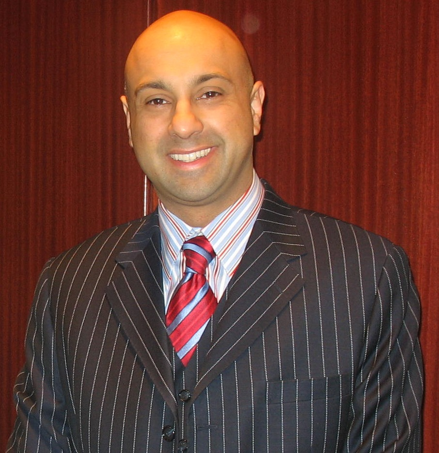 Canadian TV journalist Ali Velshi is smiling for the picture