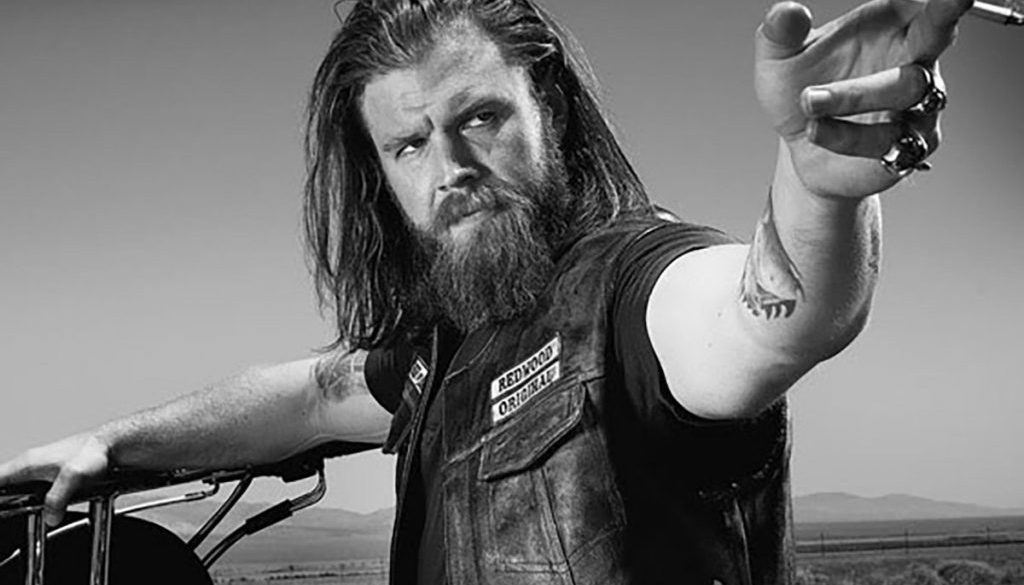 Ryan Hurst as Opie Winston holding a cigarette in his right hand slaying his long hair and beard look