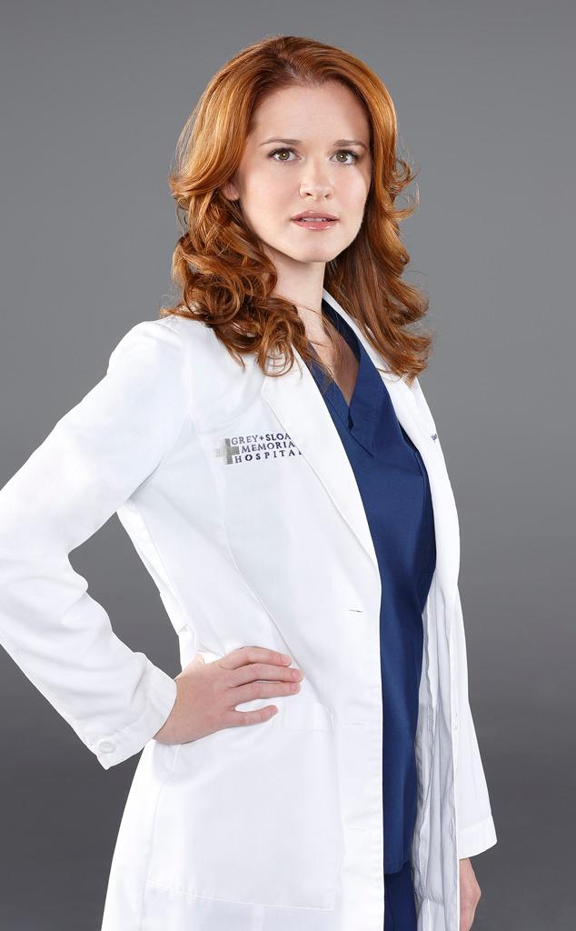 Sarah Drew wearing a doctor's uniform
