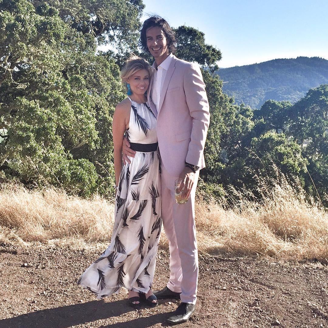 Lauren Sivan standing next to her boyfriend Todd Oren who has his hand around her waist