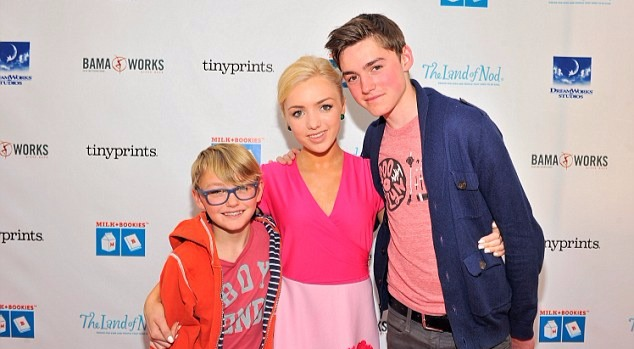 Peyton List and brothers Spencer List and Phoenix List wrap their hands around one another