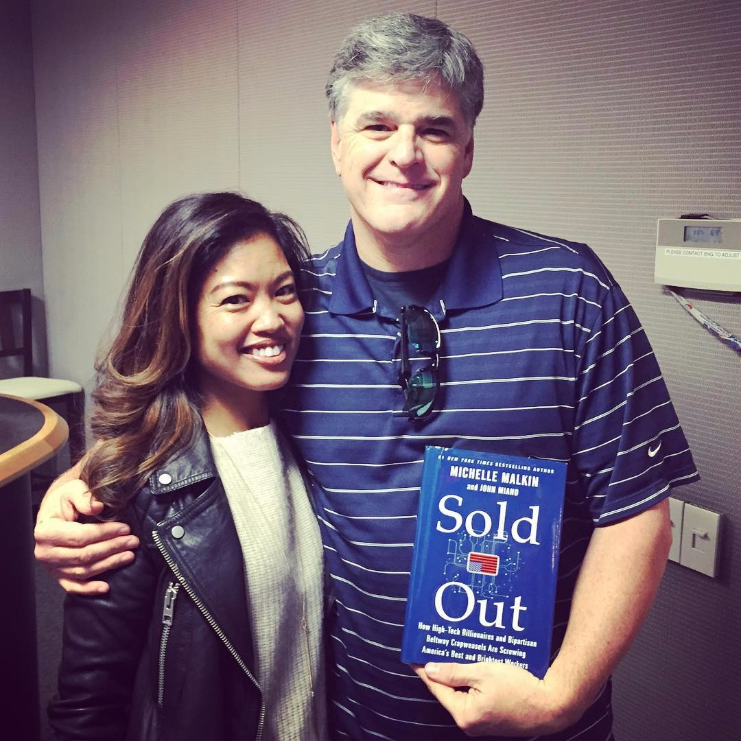Sean Hannity hugs political commentator Michelle Malkin during promotion of her book.