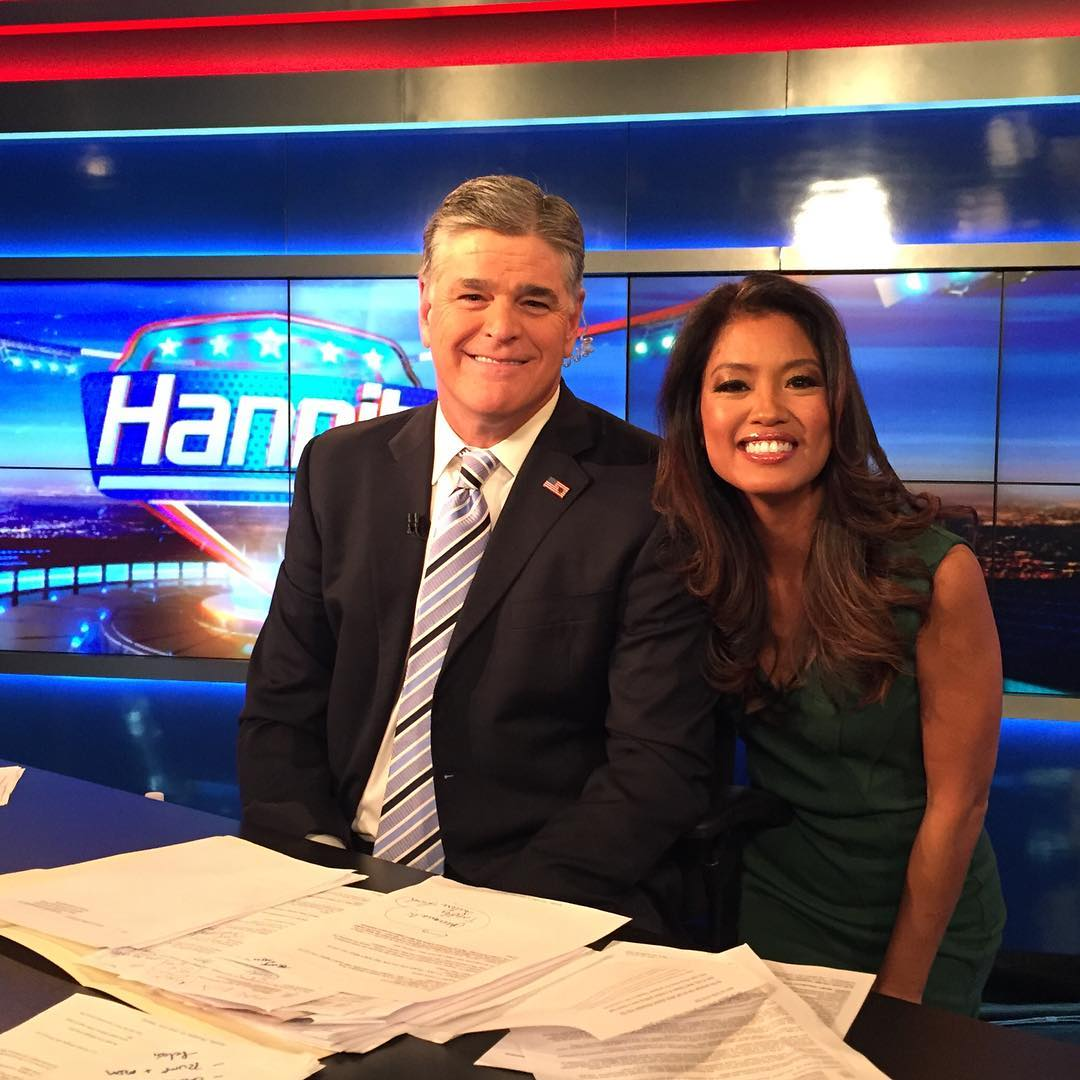 Sean Hannity accompanied by Michelle Malkin on the set of Fox News in December, 2016