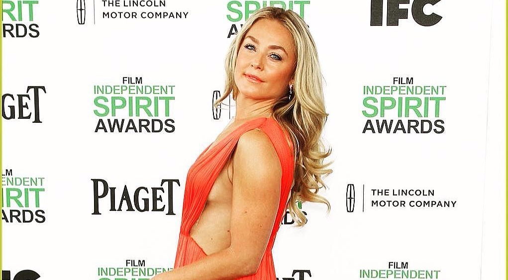 Elisabeth Rohm looking to her left, she's standing in front of a background that says Film Independent Spirit Awards