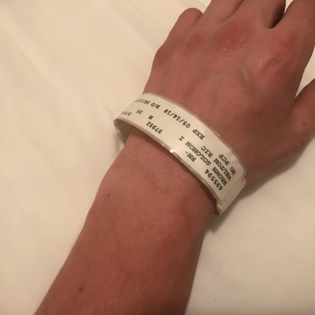 Bear Brown shared a picture of his hand with hospital band on
