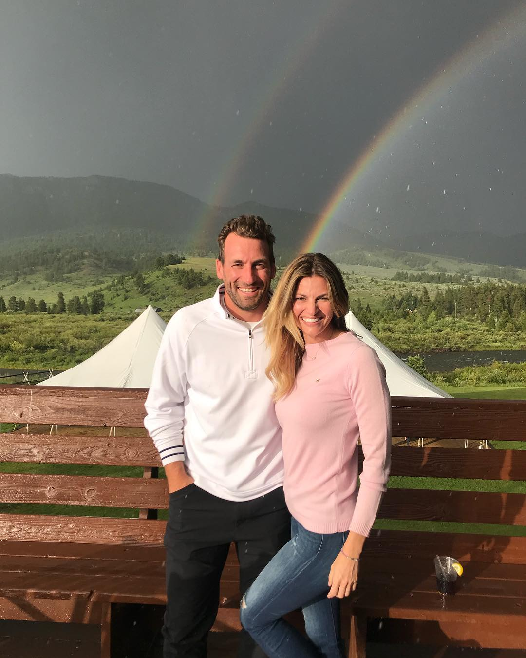 Erin Andrews and Jarret Stoll photographed in front of beautiful rainbow