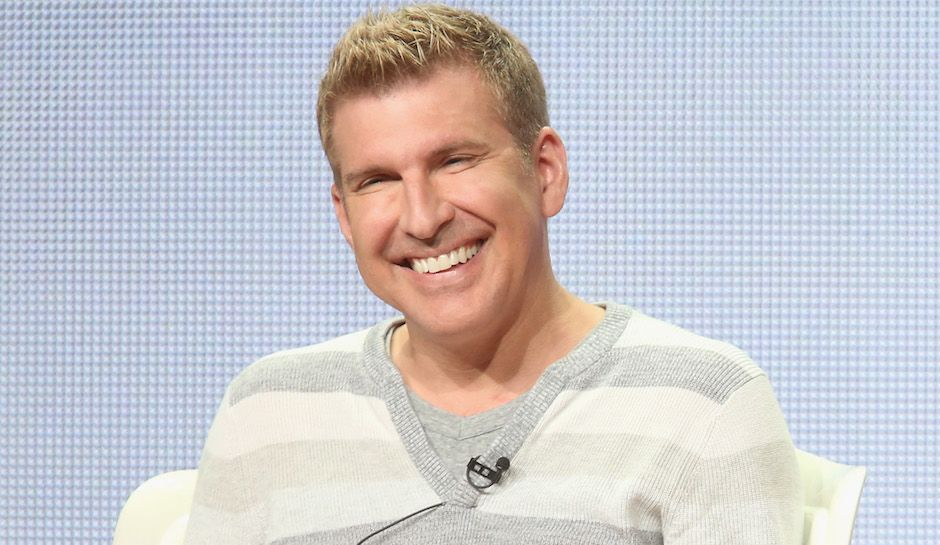 Todd Chrisley with a wife smile on his face