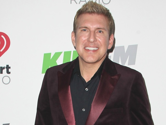 Todd Chrisley looks total clad in maroon-colored velvet suit