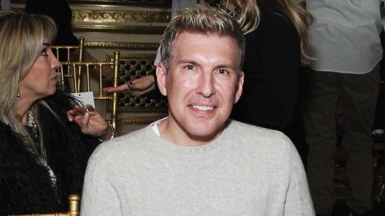 Todd Chrisley is wearing grey sweater